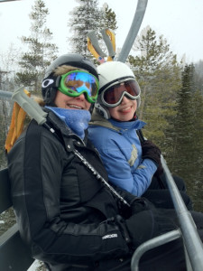 Here we are on the lift - my mom's in black, I'm in blue, and my sister Colby is behind the camera. (The trees are blurred in the background, because the chair was moving when Colb snapped the pic.)